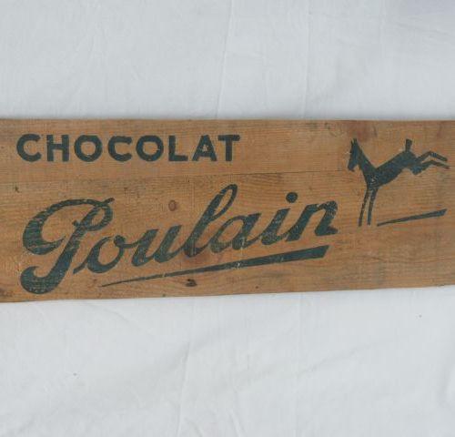 Panneau publicitaire en bois pour le chocolat Poulain.Dimensions 21 x 64 cm