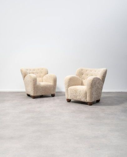 Travail SUÉDOIS Pair of armchairs Upholstered sheep's wool, leather buttons, and…