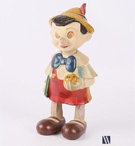 Sujet Pinocchio en résine peinte articulé, fonctionnement à clef Etiquette sous …