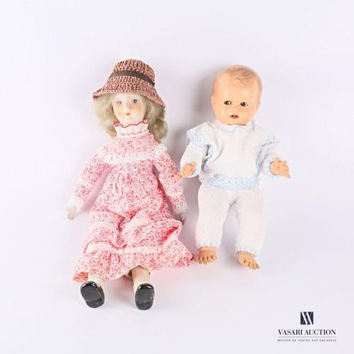 Two dolls, one with porcelain head and feet, the body in foam, the other in plas…