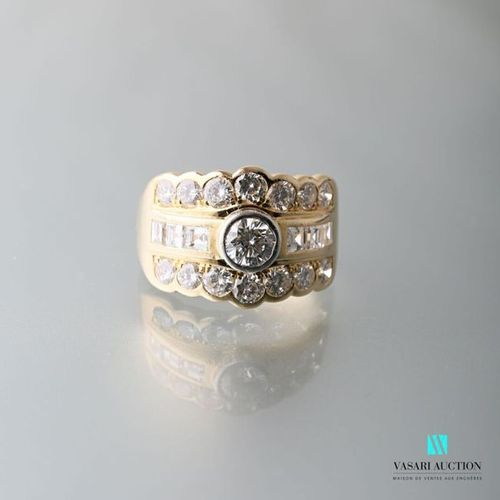 750 thousandths yellow gold band ring set with three rows of diamonds: two of se…