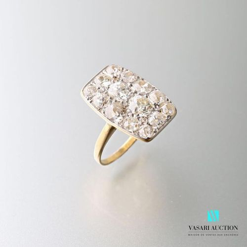 Ring in 750 thousandths yellow gold, rectangular pattern paved with old cut diam…