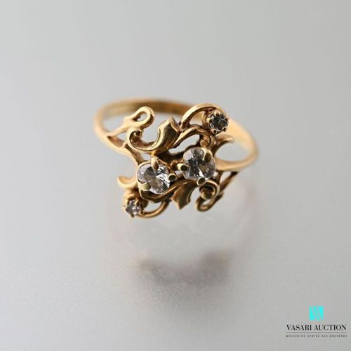 Ring in the style 1900 in 750 thousandths yellow gold set with four diamonds in …