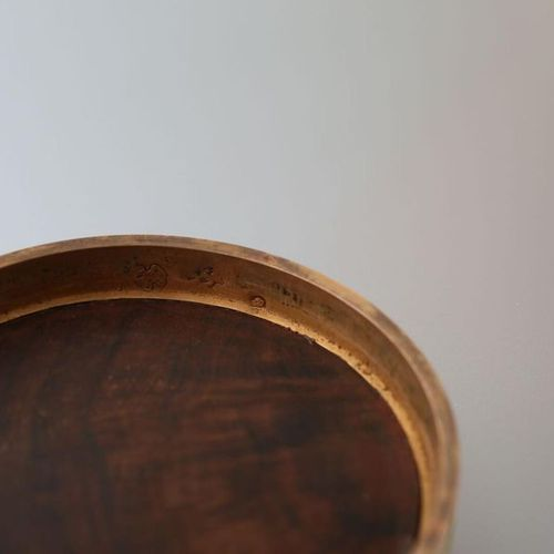 Round wooden and gold box, decorated with a charcoal drawing with animated pasto…