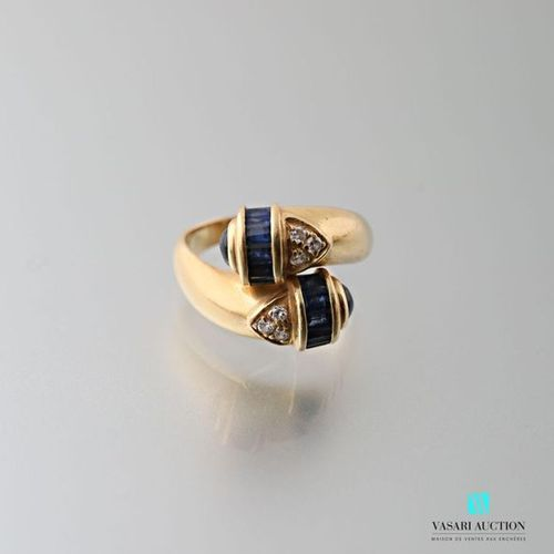 Crossed ring in 750 thousandths yellow gold set with baguette sapphires, small b…