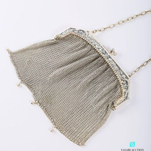 Silver metal mesh bag, the closure decorated with leafy and flowery branches. (m…