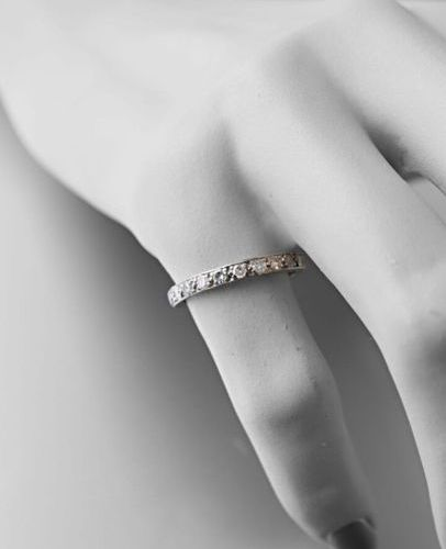 Wedding band in 750 thousandths white gold set with 8/8 cut diamonds Gross weigh…