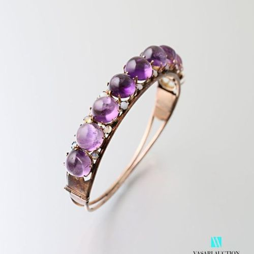 Rigid bracelet opening in 585 thousandths gold set with eight round amethyst cab…