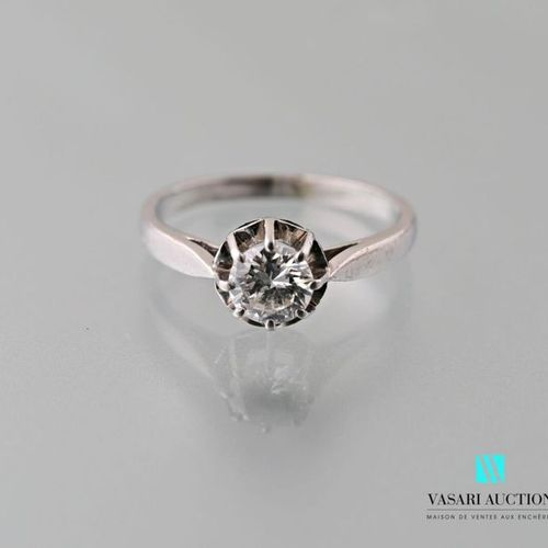 Platinum ring 850 thousandths set with a half size solitaire diamond of about 0.…