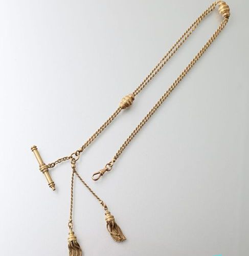Gold gilletière chain with double rows of twisted mesh with two runners, two pom…
