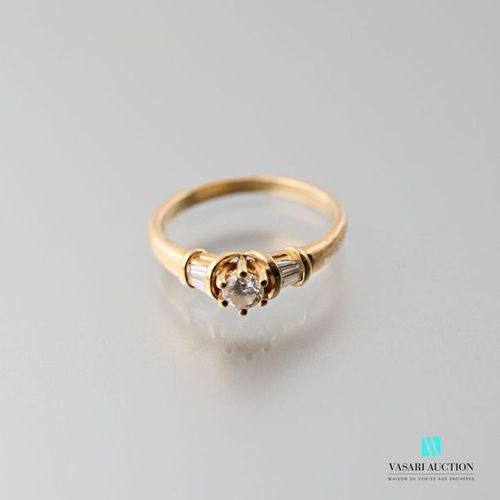 750 thousandths yellow gold ring set with a central brilliant of approximately 0…