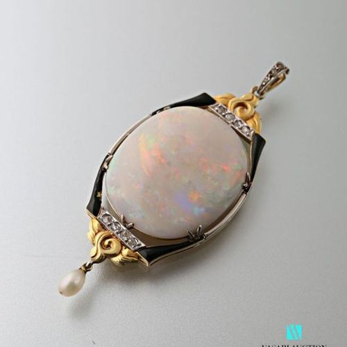 750 thousandths gold pendant set with an opal in a black enamelled frame decorat…