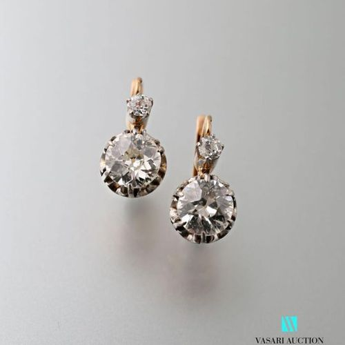 Pair of 750 thousandths gold sleepers each set with two old cut diamonds, early …