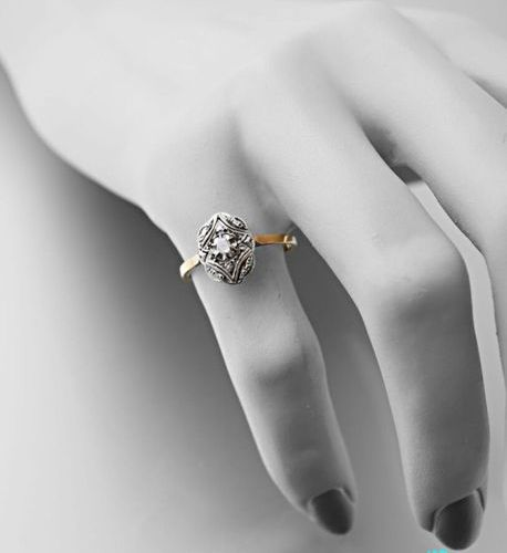 Ring in yellow gold 750 thousandths and platinum 850 thousandths, oval openwork …