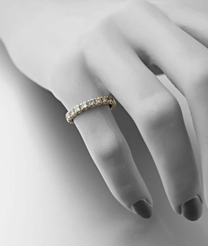 American wedding band in 750 thousandths gold set with 20 brilliants of approxim…