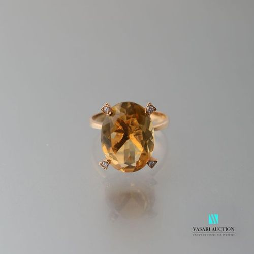 750 thousandths yellow gold ring set with a pretty oval citrine punctuated with …