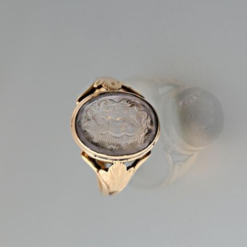 Yellow gold 750 thousandths signet ring set with a white stone intaglio engraved…