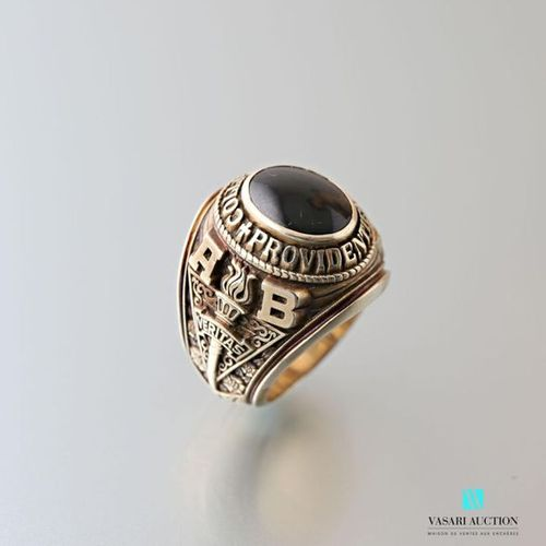 9 karat gold university ring set with a cabochon onyx surrounded by the inscript…