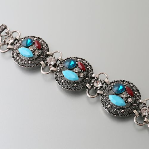 Bracelet decorated with three medallions set with coloured fantasy stones  Lengt…