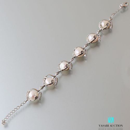Metal bracelet adorned with six freshwater cultured pearls, the clasp snap hook.…