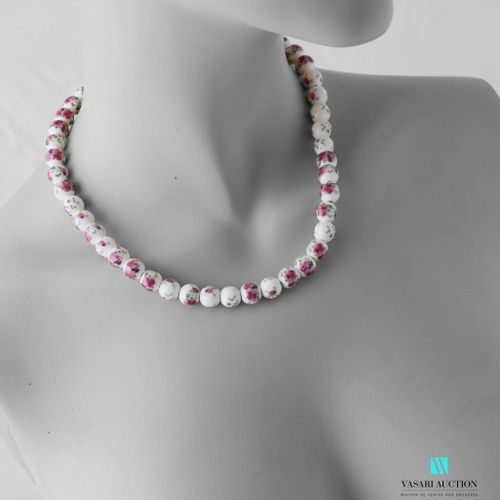 Necklace made of ceramic beads decorated with flowers, the clasp snap hook in me…