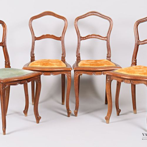 A suite of four chairs in moulded natural wood, with an animated backrest adorne…