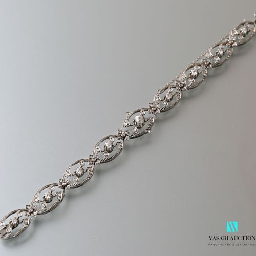 Supple Belle Epoque bracelet in 750 thousandths white gold, nine animated shuttl…