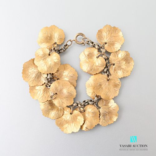Gold plated metal bracelet with mesh supporting fifteen charms simulating leaves…