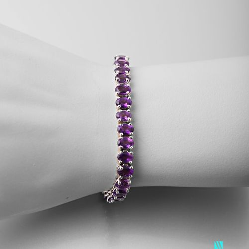 Silver line bracelet decorated with oval amethysts  (two links welded together) …