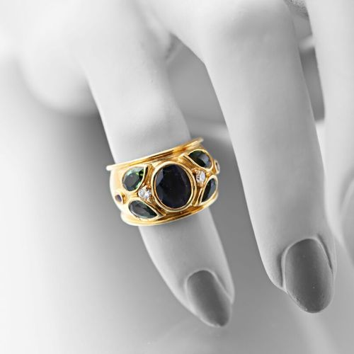 Cartier, large hoop ring set with an oval iolite in the centre with two pear sha…