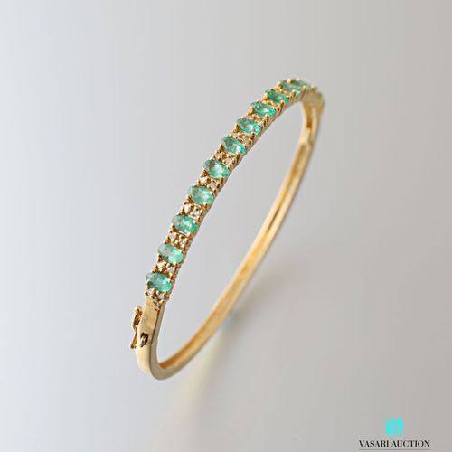 Vermeil bracelet decorated with oval cut emeralds alternating with small diamond…