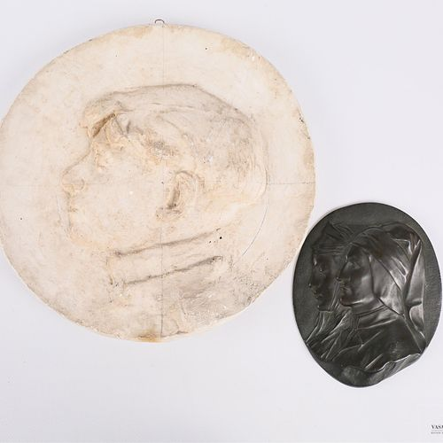 Set of two medallions including :  Plaster medallion representing a profile of a…