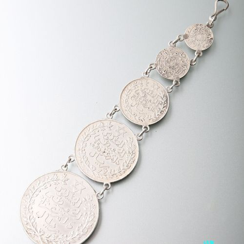 Silver pendant decorated with five Tunisian coins arranged in fall.  Length : 13…