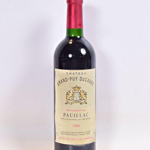 1 bouteilleChâteau GRAND PUY DUCASSEPauillac GCC2004  Et. Tachée et écornée.…