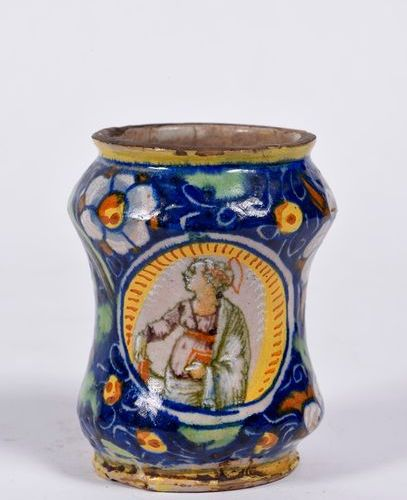 Small albarello in majolica decorated with flowers and fruits on a midnight blue…