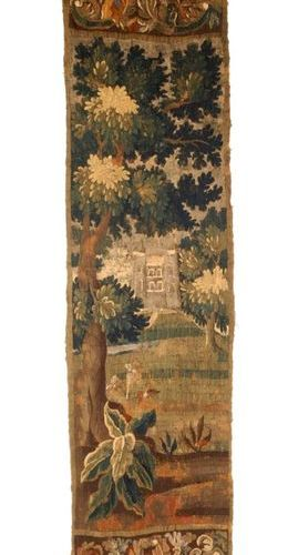 Fragment of a wool and silk tapestry decorated with a castle and greenery. Franc…