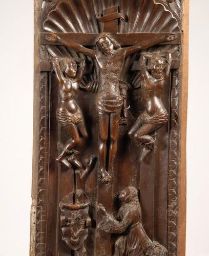 Crucifixion. Walnut wood panel carved in deep relief, representing Christ surrou…