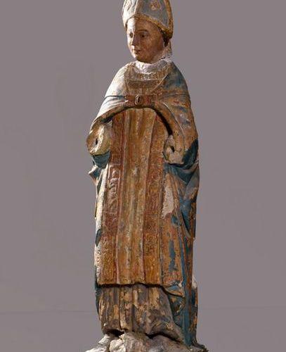 Limestone bishop's saint carved in the round. XIVth XVth century. H. 155 cm. Pos…