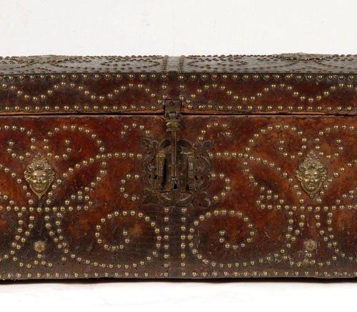 Travel trunk with wood core covered with studded leather. On the front and on th…