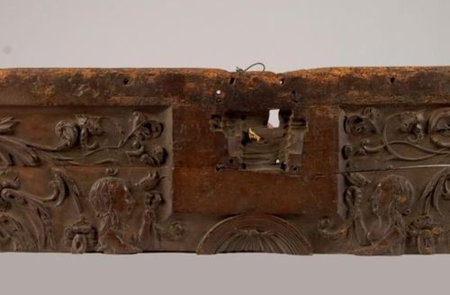 Trunk front element made of wood carved with foliage, profiles of women and helm…