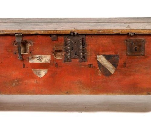 Wooden chest painted in red with a coat of arms decoration. Wrought iron reinfor…