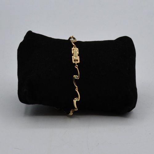 SENSI DI DONNA  Parure en métal doré, perles et strass comprenant :   Un collier…
