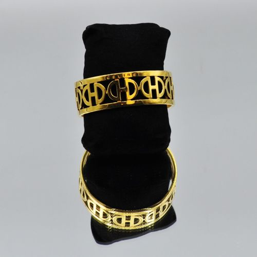 CELINE Made in Italy  Bracelet jonc en métal doré ajouré. Diamètre : 7 cm    Le …