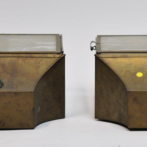 A pair of rectangular gilt metal and glass lantern sconces, the upper part surmo…