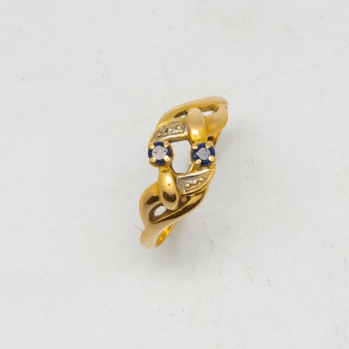 Yellow gold ring decorated with an interlaced pattern punctuated by two small sa…