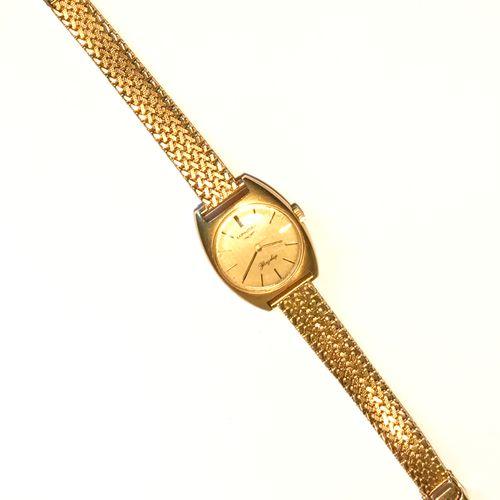 LONGINES  Montre de Dame Flagship n° 16525839 en or jaune (poinçon hibou). Cadra…