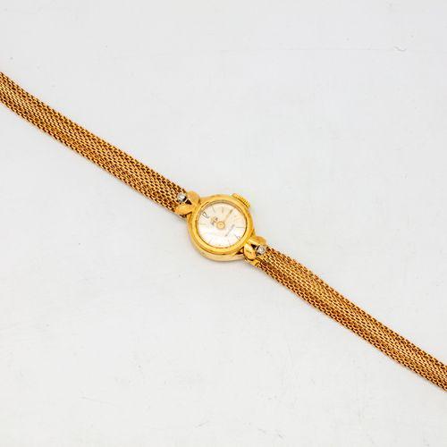 Montre de dame en or jaune, marque Philippe, cadran rond, bracelet souple en or …