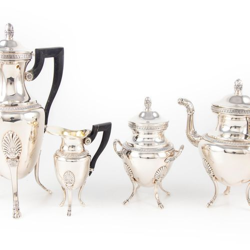 Tea and coffee set in silver plated metal chased with water leaves. Tripod base …