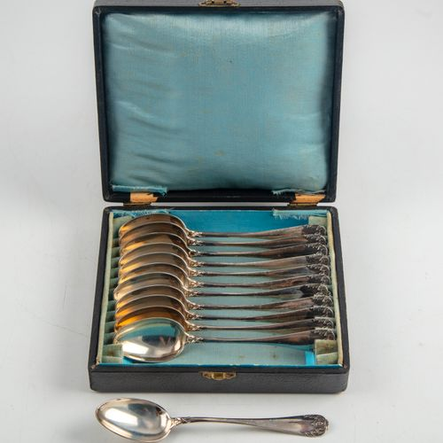 12 small silver spoons  M.O.: not read Minerve hallmark Weight: 288 g.  In a cas…