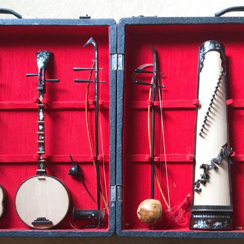 VIETNAM VIETNAM  Set of eight string or wind musical instruments made of exotic …